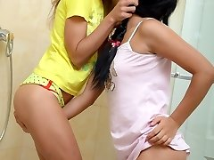 Superb youthful teen lesbians Stephanie and Isabel lick and toy wet pussies at the shower