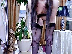 Upskirt teaser in black seam-n-heel stockings exposes her round ass cheeks