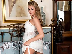 Danielle strips out of her slinky chemise, bullet bra and sheer lace trimmed panties.