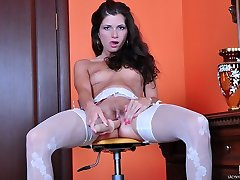 Playful girl flashes her white patterned stockings before a super-steamy dildo show