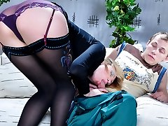 Bossy chick in luscious patterned stockings lures a nerdy boy into a fuck