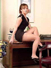 cute secretary in pantyhose at her desk