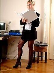 Blonde secretary Emilly in fashion pantyhose posing on office desk