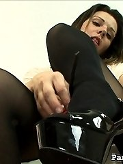 Our creepy camera man has found another model type, the sexy Tess, strutting around town in sexy pantyhose. He follows her everywhere she goes, zooming closely on her stockings, trying to see up her tight red skirt.