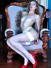 Leggy smasher in a red dress and lush white stockings toying her love box