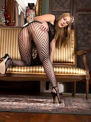 Lovely blonde Aston shows off in a stunning pair of striped hose, very sexy with sexy glimpses of her through the pattern.
