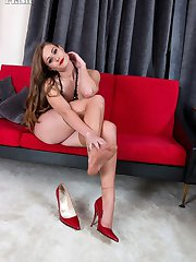 Honour starts by her teasing with her heels and flashing her stocking tops, but soon gets much much more intimate, and very horny!