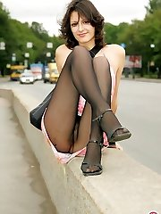 Horny babe in black tights knowing the best way of posing outdoors