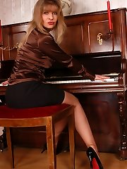 Angel the piano doll in sheer brown stockings