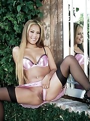 Pretty Latina Jennifer Luv unveils her stockinged legs and pulls her pink undies aside