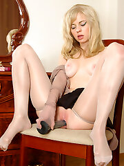 Awesome blondie with pantyhosed hands taking advantage of huge rubber pole
