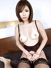 Mai Kuroki Asian in stockings plays with tongue all over penis