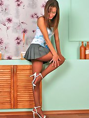 Steamy upskirt chick sniffing and licking her pantyhose clad feet fervently