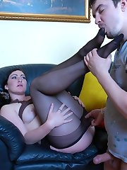 Sex-crazy chick in black lacy pantyhose kneels down after wet foot-licking
