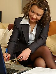 Voluptuous business lady in lacy black stockings toying her holes by turn
