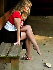 Angel public in glistening and suntan pantyhose