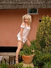 blond toys in her layered nylons outdoors