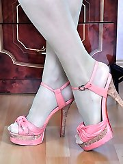 Fashionable doll showcases off high arc feet in green tights and various high heels