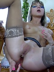 Pretty babe tongues her glass toy before spreading nyloned legs for solo rectal