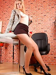 Angel the secretary in suntan and sheer hose