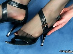 Spicy chick in dark-hued sheer-to-waistline hose embellishing her feet with beads