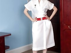 Nurse Michelle in white ff nylons attending to the patient's every need!