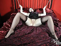 Curvy red head Jay is looking sexy in her lingerie and nylons and flashing her shaved pussy