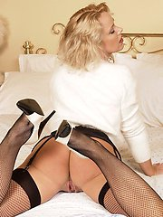Blonde mature hottie in stockings with big tits