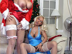 Horny Milf Lana Cox has some filthy festive fun with her busty real life Miss Clause sex doll...