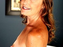 Mature babe Cindi Thompson plays with her hairy pussy.