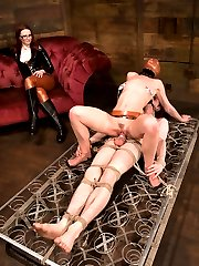 She has her hands full with two submissive sluts, but Miss Adams has enough sadism to keep them in check.  Kade is a little pain slut and takes a vicious cane and clamp scene.  He is quickly made to understand that he is indeed weak and has no control, reinforced with a  fierce ass fucking.  Gimp girl is far from safe if she does not impress the Mistress with her cock sucking skills.  The little fuck puppet is soon bouncing on the hard cock as Claire pours hot wax all over them both and whips it off.    Miss Adams pushes both these sub's limits and brings them out the other side smiling.  Good show, Miss Adams.