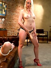 When Cherry flakes on Rico's call, her agency sends over a replacement who is not exactly the same kind of girl.  Lorelei Lee is gorgeous in vintage stockings, heels and corset.  Her case of implements has her obnoxious client squirming like a worm on a hook as she paddles, slaps, spits and fucks this guy up to teach him who is the one to be eating cum on this particular night.  After pinning his cock, balls and tits with clothespins, she grinds her pussy all over his face, then beats his nuts with a crop to be sure he gets her point.  She somehow gets herself off on his pathetic cock before reaming his asshole with a strap on the size of her arm.  Of course the little shit spills his filthy spunk all over her hand so has to clean it off with his mouth.  At least that shut him up.