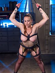 Daisy Ducati dominates tough slut, Bella Rossi with dynamic suspension bondage, the violet wand, zapper, samurai, tens unit sticky pads and electrified dick on a stick! Daisy demands to be serviced with satisfying static charged pussy licking!