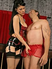 Stunning domina practicing a whipping session on her bound and ball-gagged slave