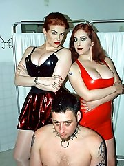 Two redhead dominatrix bathing their male gimp before training session
