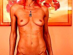 Skinny older babe Klarisa Hot spreads her ass.