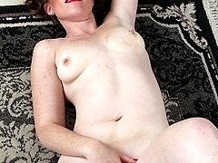 Mature amateur Jayme Lou spreads her hairy pussy.