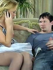 Sexy blondie in a flying skirt and soft grey hose getting nailed on a sofa