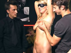 Busty blonde Luci is put on display in front of eager tourists. A group forms to watch her...