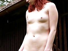 This redhead cutie has masturbated outdoors before, but never in the middle of a front lawn like she is today. She`s out in the open, rubbing her clit and fingering her tender pussy.