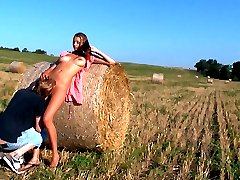 This hay bale is their bed today. Underneath the warm sun feels so natural for these horny teen lovers. They may love right out in the open, with no cares in the world.