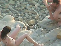 Voyeur shooting of a fucky couple doing it on a beach