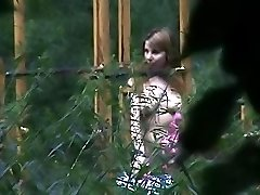 Outdoor voyeur cam movies of a changing babe