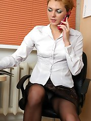 Upskirt office girl pushes down her classy black tights for some dildo fun