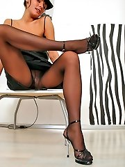 Beauty can lure any male with her long nyloned legs in spike heel sandals