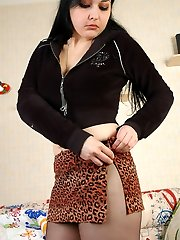 Big-titted sweetie puts on barely black pantyhose under her tiny leopard skirt
