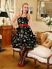 Lucy Anne looks awesome in her 50's sundress and dark-hued stockings and suspenders.
