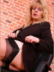 Sexy secretary shows her sexy legs in reinforced stockings