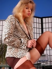 Angel at office is frolicking with her stocking toes