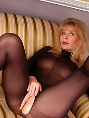 Angel in black bodystockings and black six inches heels
